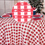84IN. RED GINGHAM ROUND PLASTIC TBLCOVER