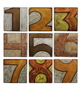 Benjara BM24093 9 Piece Wooden Square Shaped Numerical Wall decor Set, Multicolor