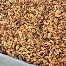 Commodity Light Amber Combo Walnut Halves & Pieces 25 Pounds - 1 Per Case