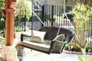 Jeco W00202S-A-FS006 Espresso Wicker Porch Swing with Tan Cushion