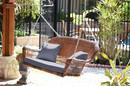 Jeco W00205S-C-FS033 Honey Resin Wicker Porch Swing With Steel Blue Cushion