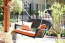 Jeco W00207S-D-FS016 Black Wicker Porch Swing with Orange Cushion